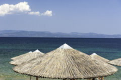 Thatched beach umbrella in Greece resort Royalty Free Stock Photography
