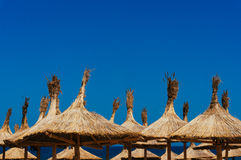 Thatched beach umbrellas Stock Photos