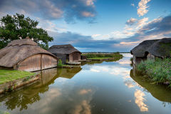 Thatched Boat Houses. Beautiful thatched boat houses floating on Hickling Broad in the Norfolk Broads stock images