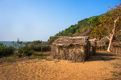 Thatched bungalows on the beach. Cheap house in Gokarna India for backpackers. Stock Image