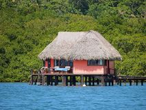 Thatched cabin above the sea Stock Photo