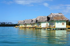 Thatched cabins over the sea Stock Photos