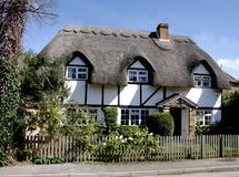 Thatched Cottage. Pretty Thatched Cottage in an English Village Royalty Free Stock Image