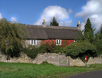 Thatched Cottage. In England stock images