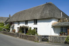 Thatched cottage. A thatched cottage in an english village Royalty Free Stock Image