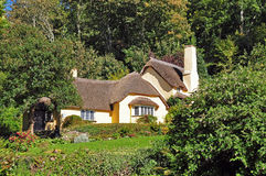 Thatched cottage. Thatched roof cottage in Selworthy Somerset, most of which are in National Trust ownership Royalty Free Stock Photo