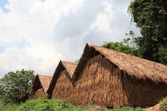 Thatched    Cottage. Thatched Roof Cottage in asia  at  mountain Royalty Free Stock Photo