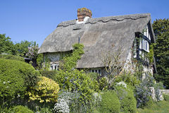 Thatched cottage. A pretty thatched cottage in a rural village in Great Britain, in spring 2009 Stock Images