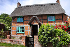 Thatched Cottage on an English Village Street Royalty Free Stock Image