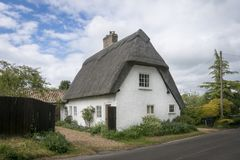 Thatched Cottage in an English Village. Street view of an old thatched cottage in the pretty village of Foxton, Cambridgeshire, England, UK Royalty Free Stock Images