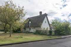 Thatched Cottage in an English Village. Street view of an old thatched cottage in the pretty village of Foxton, Cambridgeshire, England, UK Royalty Free Stock Photography