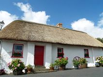 Thatched Cottage In Ireland. A traditional Irish thatched cottage at Dunhill, Co. Waterford, Ireland Stock Photography