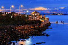 Thatched cottage night scene by the sea Stock Photo