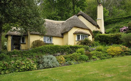 Thatched Cottage. Traditional Thatched Cottage & Gardens, Exmoor, Somerset Royalty Free Stock Photo