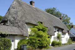 Thatched cottage at Wherwell. Hampshire. England. Thatched and whitewashed cottage in village of Wherwell in Hampshire. England Royalty Free Stock Photos