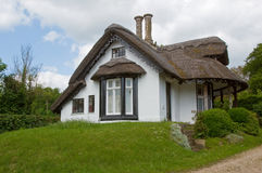 Thatched cottage. White washed walls and chimneys Royalty Free Stock Image