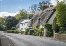 Thatched Cottages in an English Village. Street view of old thatched cottages in the pretty village of Foxton, Cambridgeshire, England, UK stock images