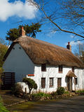 Thatched Cottage Church Cove Cornwall. Thatched cottages line the narrow road down to Church Cove near the Lizard in south west Cornwall Stock Photo