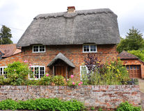 Thatched English Village Cottage and garden Royalty Free Stock Image