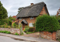 Thatched English Village Cottage and garden Stock Photo