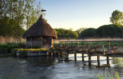 Thatched Fisherman's Hut & Eel traps. On the river Test in Hampshire Royalty Free Stock Images