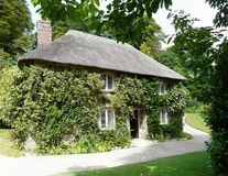 Thatched gardeners cottage. In the grounds of Lanhydrock castle in Cornwall, England Royalty Free Stock Photography