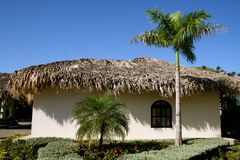 Thatched grass roof house Stock Photos