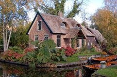 Thatched House And Boats Stock Image
