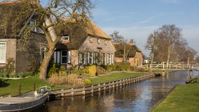 Thatched houses in Belt Schutsloo Giethoorn. Tradtiional thatched houses in Belt Schutsloo Giethoorn in the Netherlands Royalty Free Stock Photos