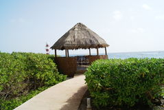 Thatched hut at the beach of Cancun in Mexico Royalty Free Stock Photo