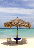 Thatched hut on a stretch of beach in Aruba Royalty Free Stock Photography
