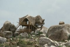 Thatched lookout on the rocks royalty free stock photo
