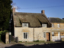 Thatched Medieval House. Thatched natural stone Medieval Village House in England Royalty Free Stock Photo