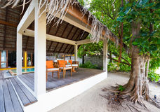 Thatched pavilion in maldives resort Stock Photography