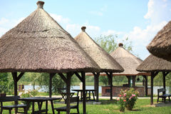 Thatched roof. Ed rest area next to the lake Royalty Free Stock Photos