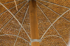 Thatched roof of beach umbrella. Thatched roof of beach umbrella close-up Stock Photo