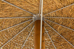 Thatched roof of beach umbrella. Thatched roof of beach umbrella close-up Royalty Free Stock Photos