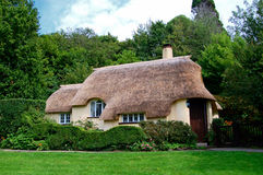 Thatched roof cottage,. Traditional thatched roof cottage on Selworthy Green in Somerset royalty free stock photo
