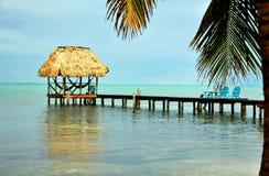 Caribbean Palapa Dock and Hammocks Royalty Free Stock Photos