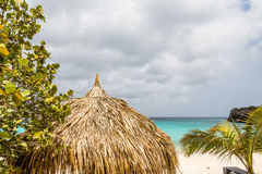 Thatched Roof on Curacao Beach Stock Images