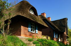 Thatched-Roof Farm House Stock Images