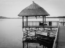 Thatched roof gazebo on wooden pier Royalty Free Stock Images