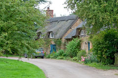 Thatched Roof House. In Cotswolds England Stock Image