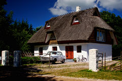 Thatched roof house Stock Images