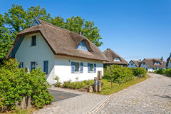 Thatched-roof house Stock Photo