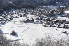Thatched roof houses covered in snow Royalty Free Stock Image