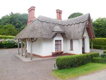 Thatched Roof Irish House. Old Irish house built in the 1800`s with a thatched roof, twig timbers and five chimney stacks located in Killarney, Ireland Royalty Free Stock Photo