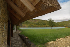Thatched roof. With a lake in the background stock photo