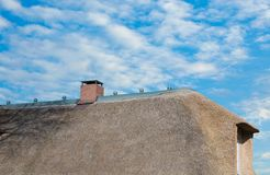 Thatched roof on the North Sea coast in closeup.  royalty free stock images