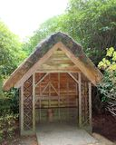 Thatched shelter, Sheffield Gardens, Sussex, England stock images